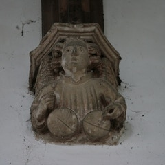 Stone Angel with Drums Below Nave Roof