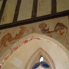 Above Window on South Wall of Chancel: Basilisk and Griffin