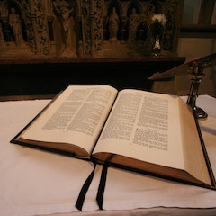 Bible Open at Psalms on Altar