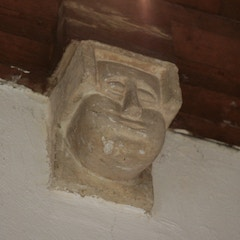 Puff-Cheeked Corbel-head in North Transept
