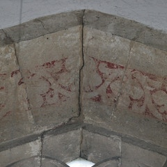 Traces of Red Paint Above North Transept Window