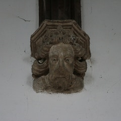 Stone Corbel-Head Below Nave Roof