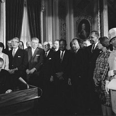 Photograph of President Lyndon Johnson Signs the Voting Rights Act as Martin Luther King, Jr., with
