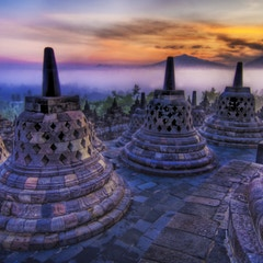 The sunrise as the caged Buddhas look on...