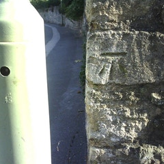 Benchmark on wall at entrance to Balliol College sports facility
