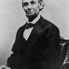 Formal photograph of seated Abraham Lincoln