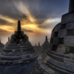 Caged Buddhas High in the Temple in Borobudur