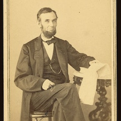 [Abraham Lincoln, U.S. President. Seated portrait, holding glasses and newspaper, Aug. 9, 1863] (LOC