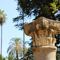 Roman capital in the Alcazar Gardens, Sevilla, Spain